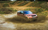 Land Rover Discovery playing in the mud