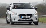 Mazda 2 Sport Black on the road