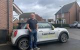 Mike Nunn teaches pupils in a Mini E, having first bought a Renault Zoe