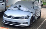 Volkswagen Polo with cover partly on