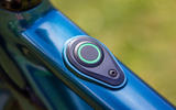 Sleek design is at the core of the Ribble Hybrid AL e's offering; this is the e-mode button