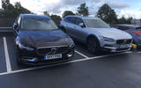 Two Volvo V90s in a car park
