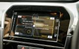 A close up of the Suzuki's infotainment system