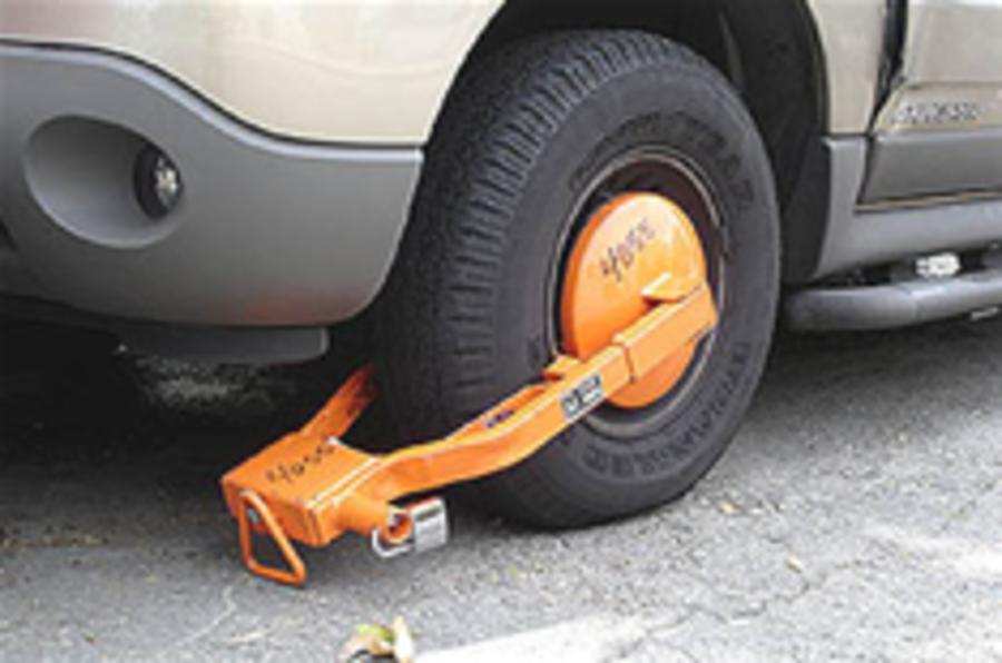 Clamped car cut in half