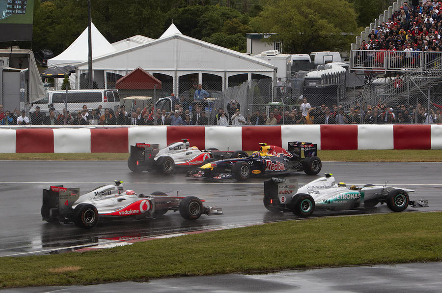 Button triumphs in Canada classic
