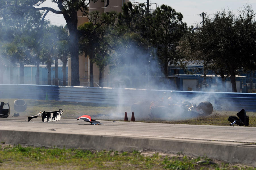 Racer unhurt in huge crash - pics