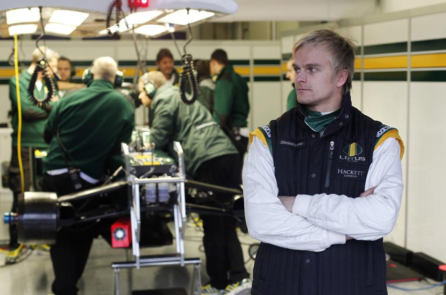 Lotus crashes; Barrichello fastest