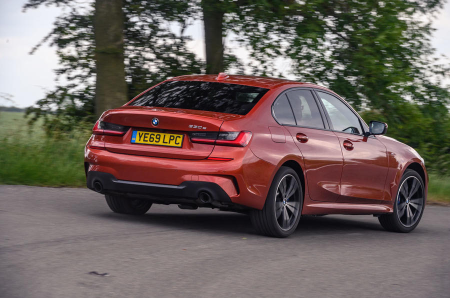 BMW 3 Series 330e 2020 road test review - on the road rear