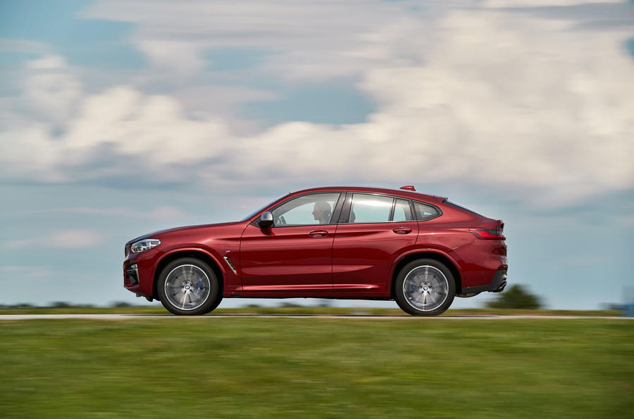 BMW X4 2018 road test review on the road side
