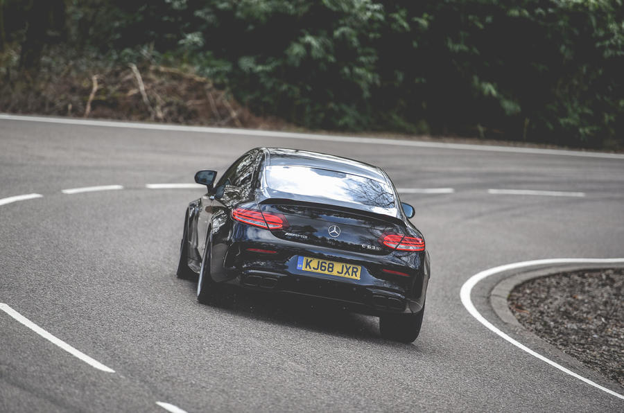 Mercedes-AMG C63 Coupé 2019 road test review - cornering rear
