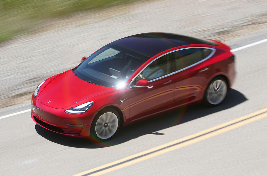 Tesla Model 3 2018 road test review on the road top left
