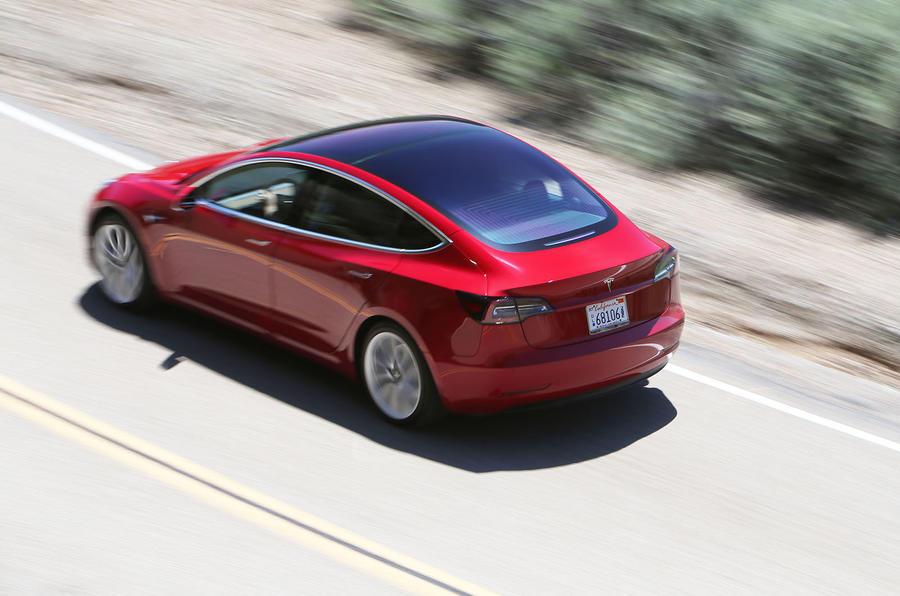 Tesla Model 3 2018 road test review on the road rear left
