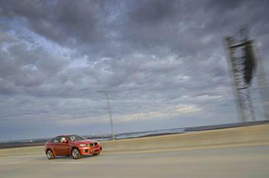 BMW X6 M on the beach
