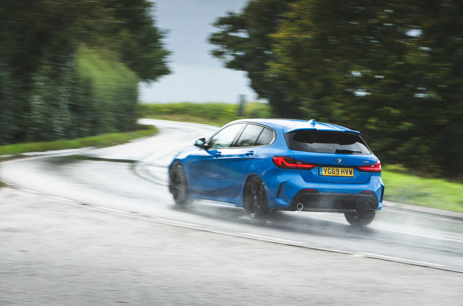 BMW 1 Series 118i 2019 road test review - on the road rear