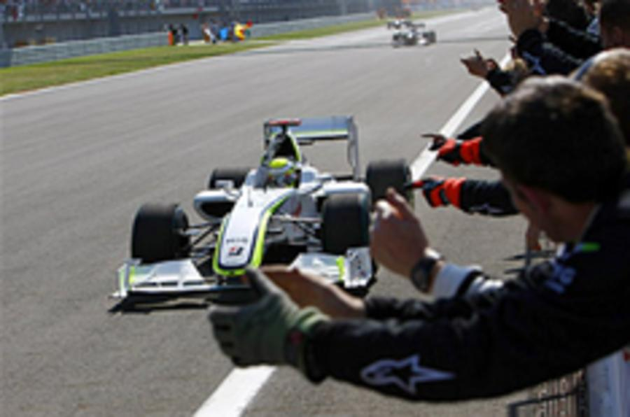 Button eases to victory in Turkey