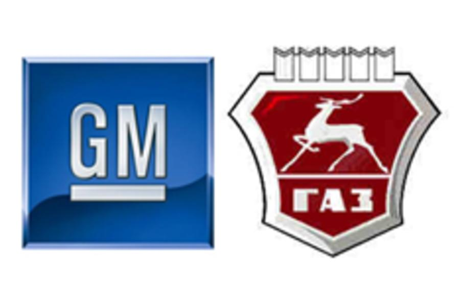 Russian car maker buys share in GM