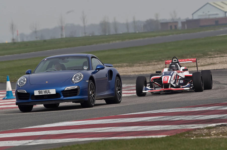 Porsche's 911 Turbo S takes on an F4 racer
