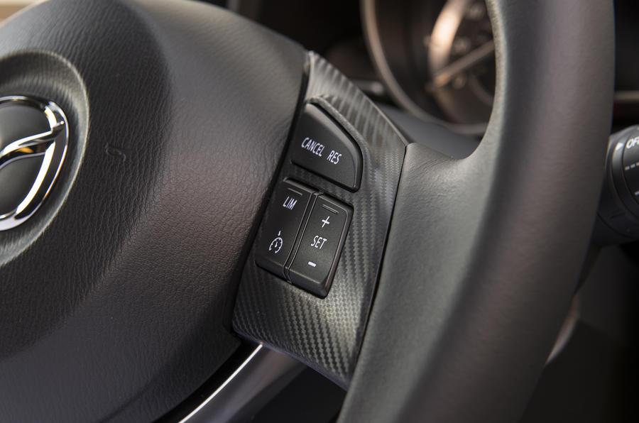 Mazda 3 steering wheel buttons