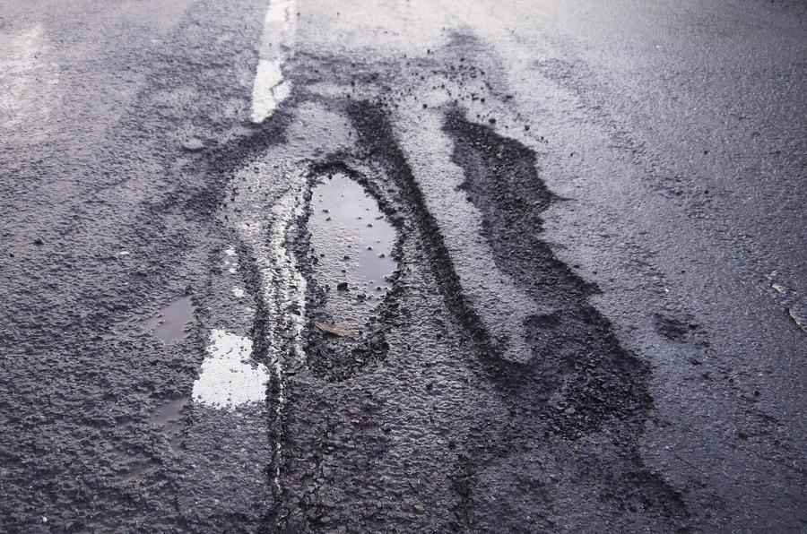 Government pledges an extra £140m for pothole repairs