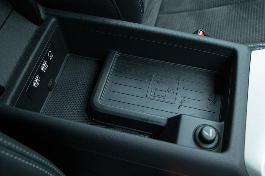 The Audi A4 is fitted with wireless charging port in the arm rest