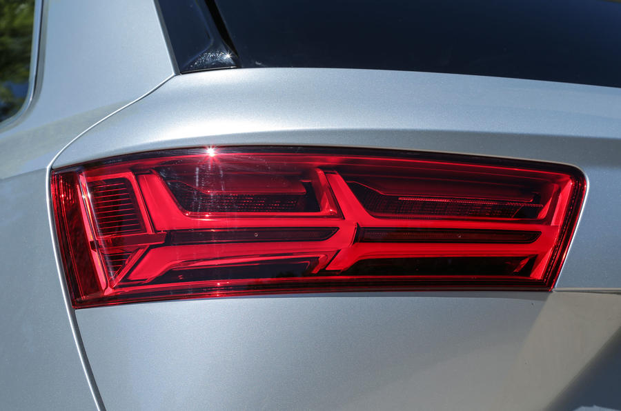 The Audi Q7's rear lights include the visual drama of the indicators sweeping left to right