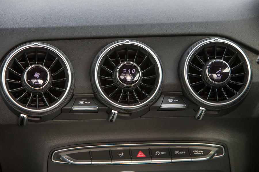 The triple vents and climate control switchgear on the Audi TT