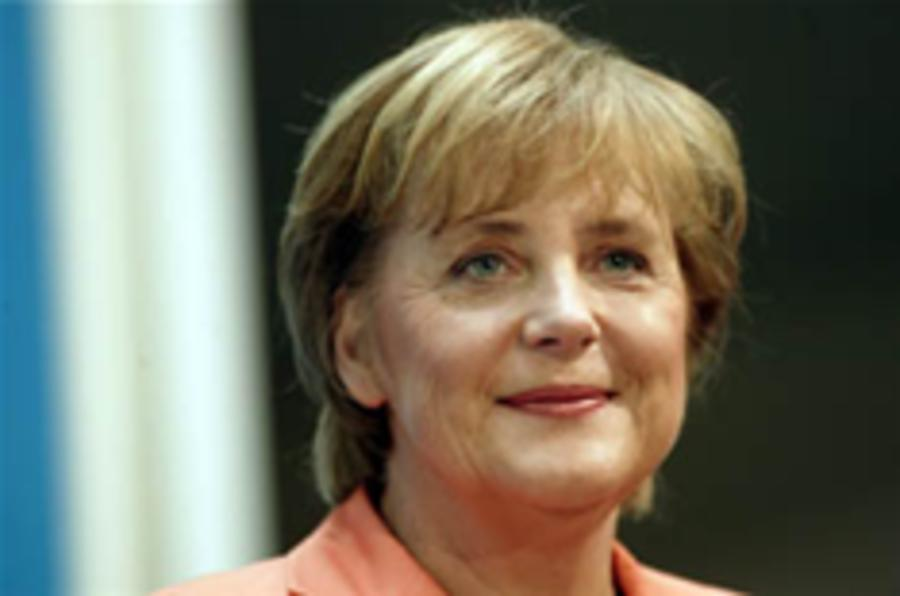 Merkel hits back for German car-makers