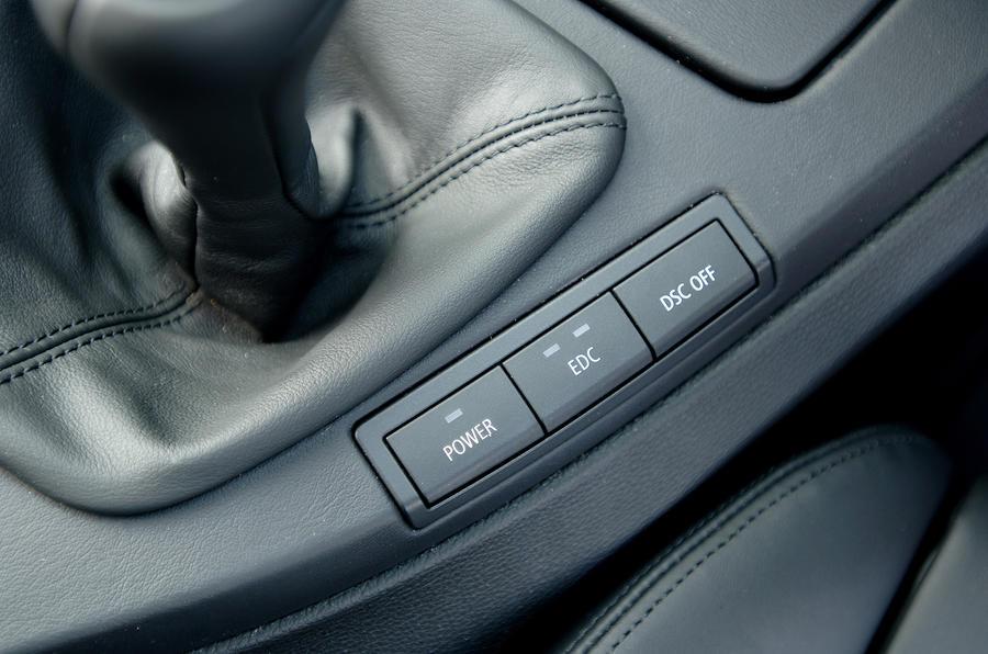 BMW M3 electronic damper button