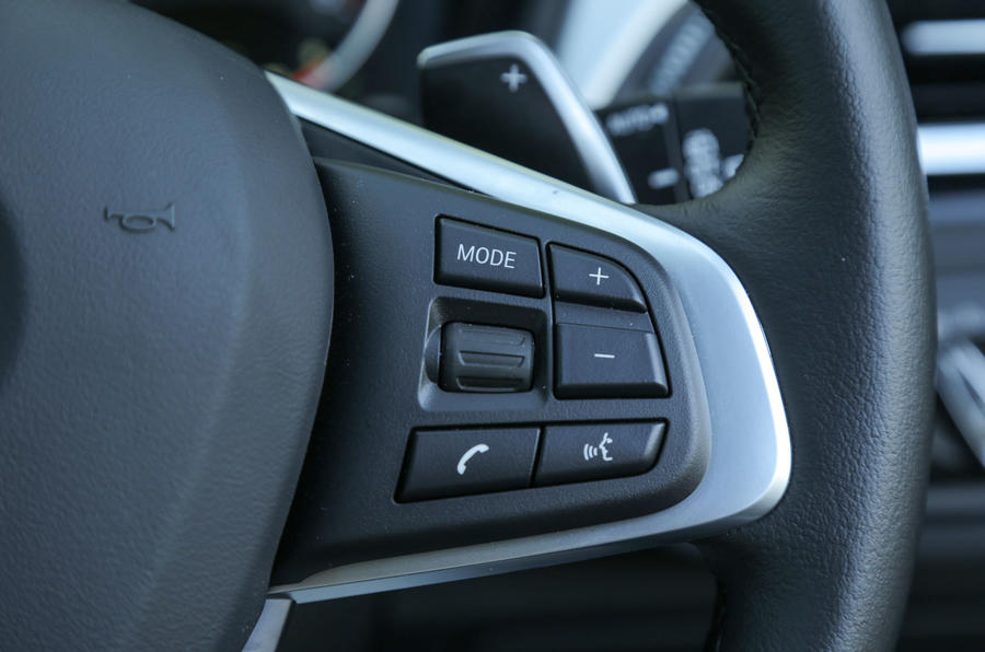Some of the audio controls on the BMW X1's steering wheel