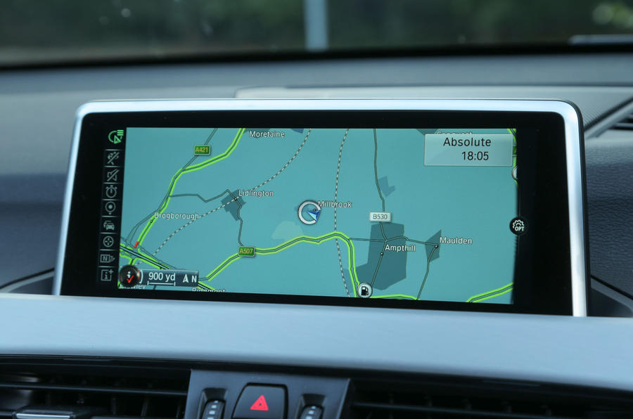 A close up of the widescreen iDrive screen in the BMW X1