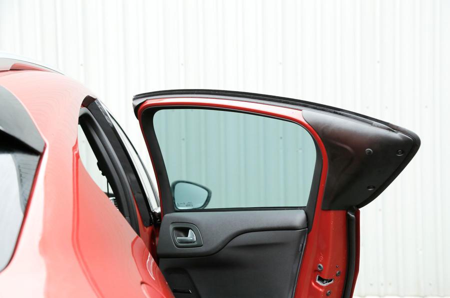 The longer leading edges on the rear doors help conceal the door handles