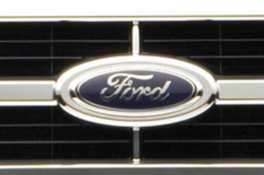 Ford halves its US workforce