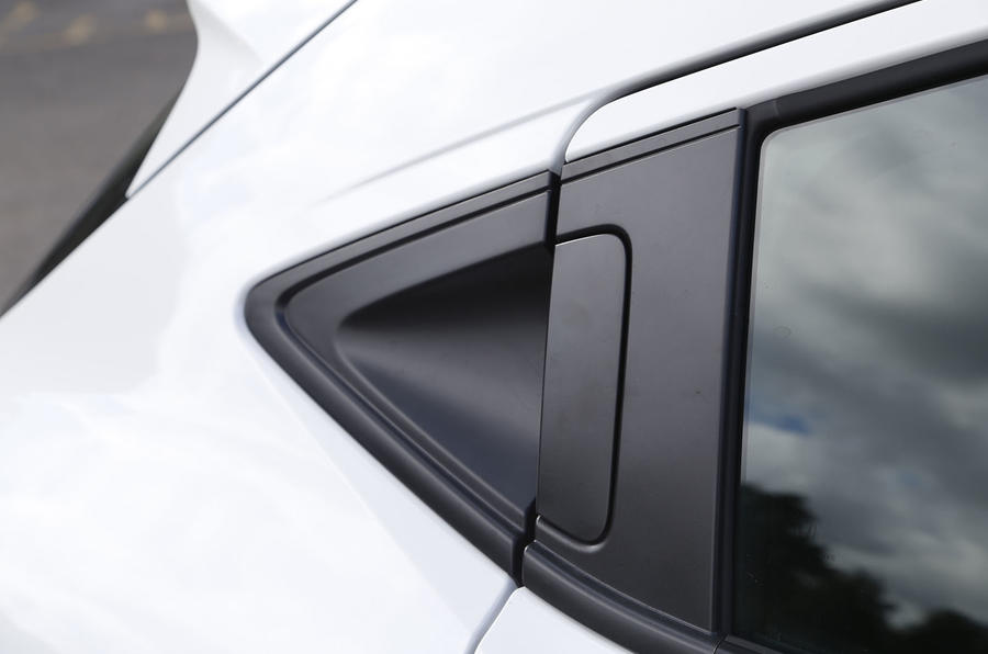 Door handles are concealed in the C-pillars on the Honda CR-V just like the Civic