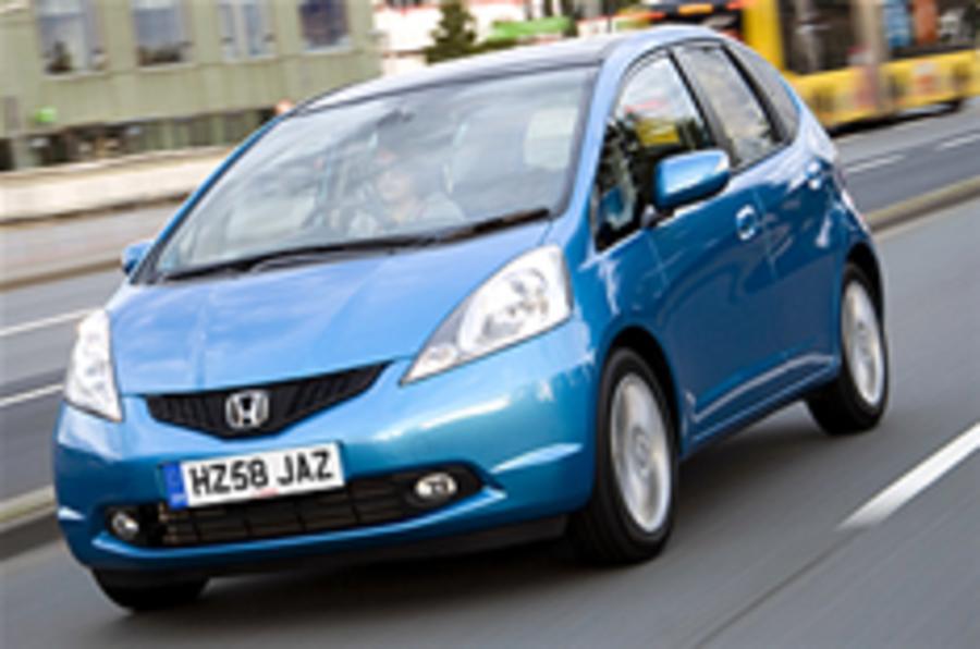 Honda profits plunge