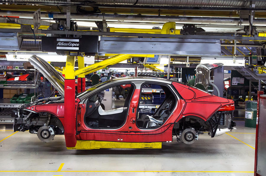 Partly assembled car in factory