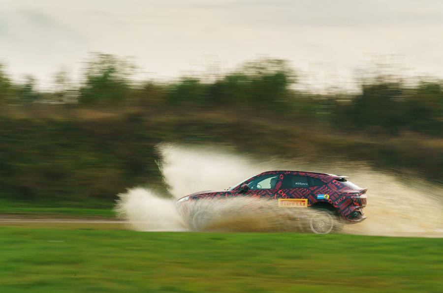 2020 Aston Martin DBX camouflaged prototype ride - splash