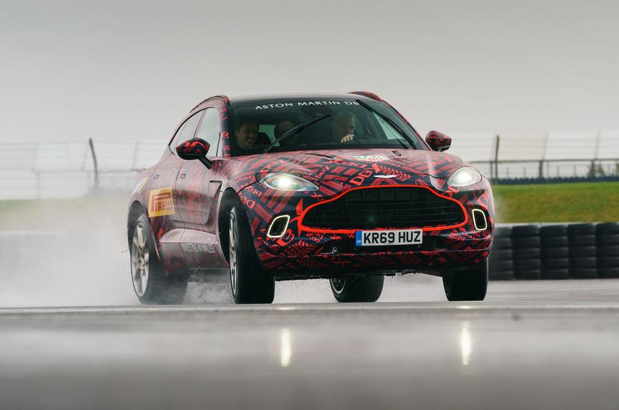 2020 Aston Martin DBX camouflaged prototype ride - oppo
