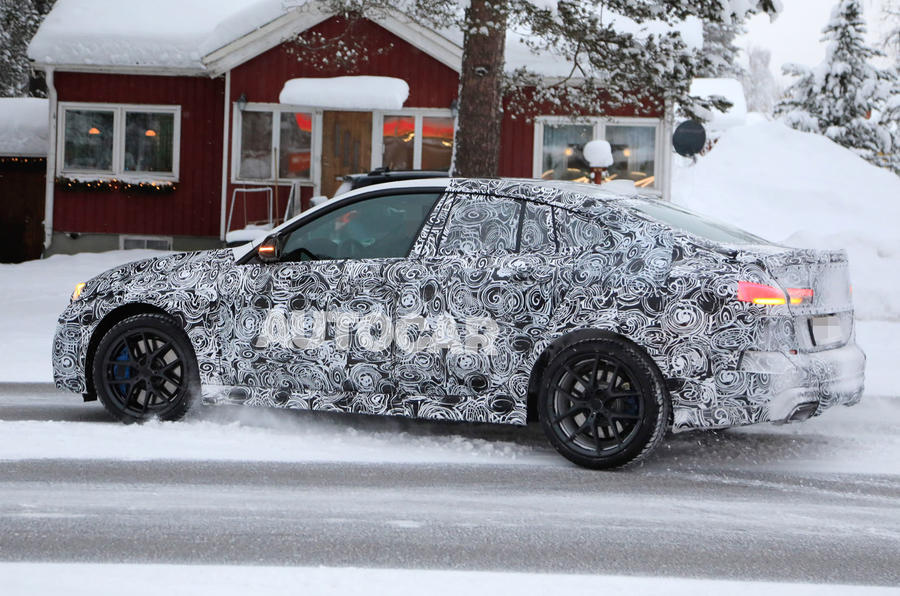 BMW 2 Series camouflage winter testing 2019 - leaving petrol station