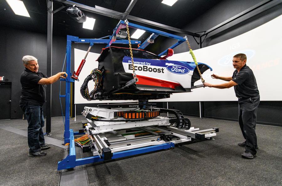Technicians working on simulator