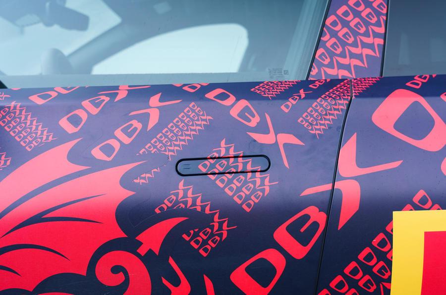 2020 Aston Martin DBX camouflaged prototype ride - door handles