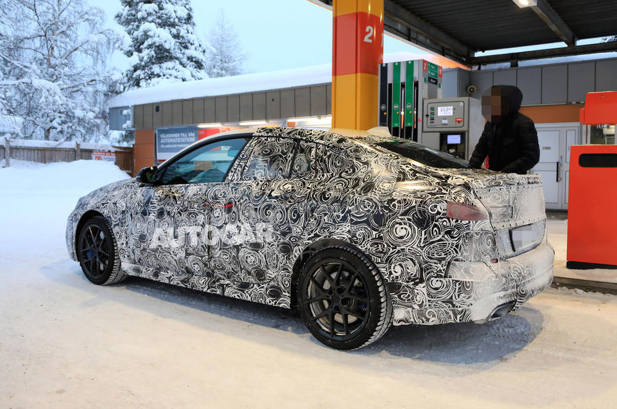 BMW 2 Series camouflage winter testing 2019 - petrol station rear