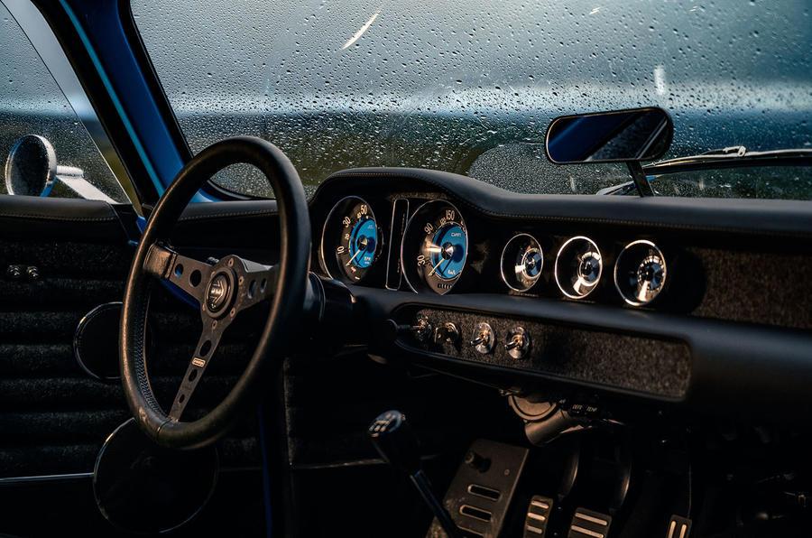 Cyan Volvo P1800 drive - cabin