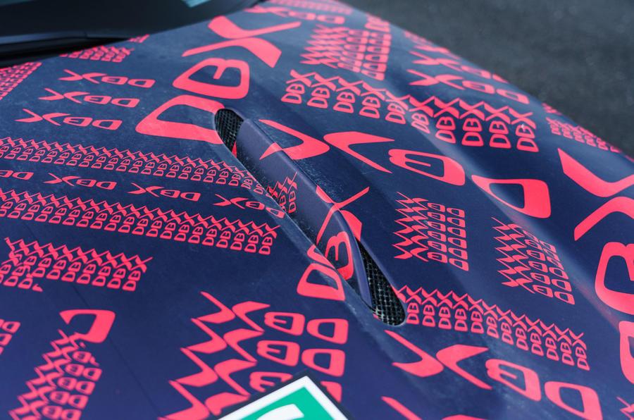 2020 Aston Martin DBX camouflaged prototype ride - bonnet vent
