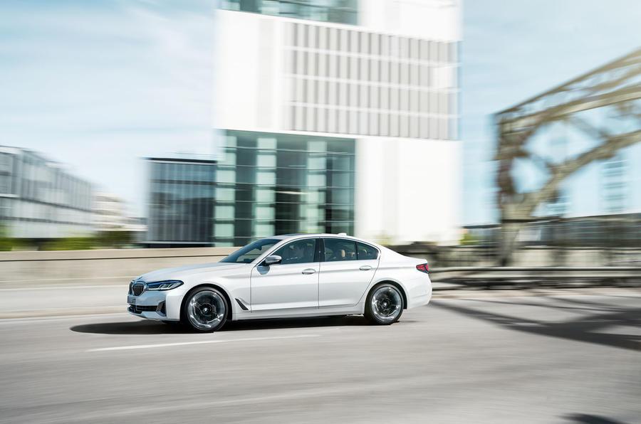 BMW 540i 2020 facelift official images - tracking side