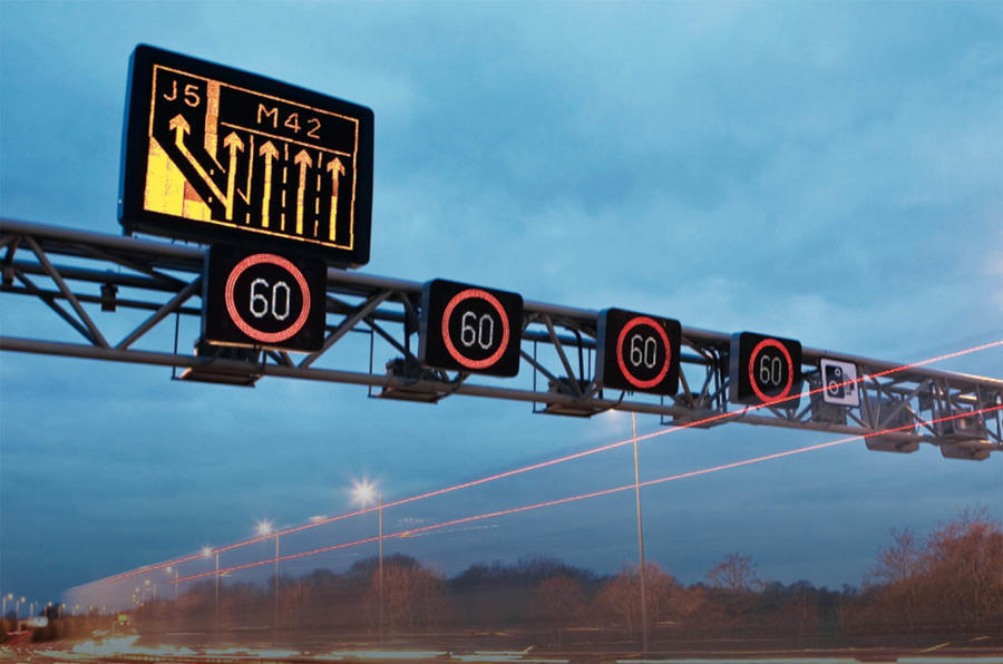 Speed limit signs over M42 smart motorway