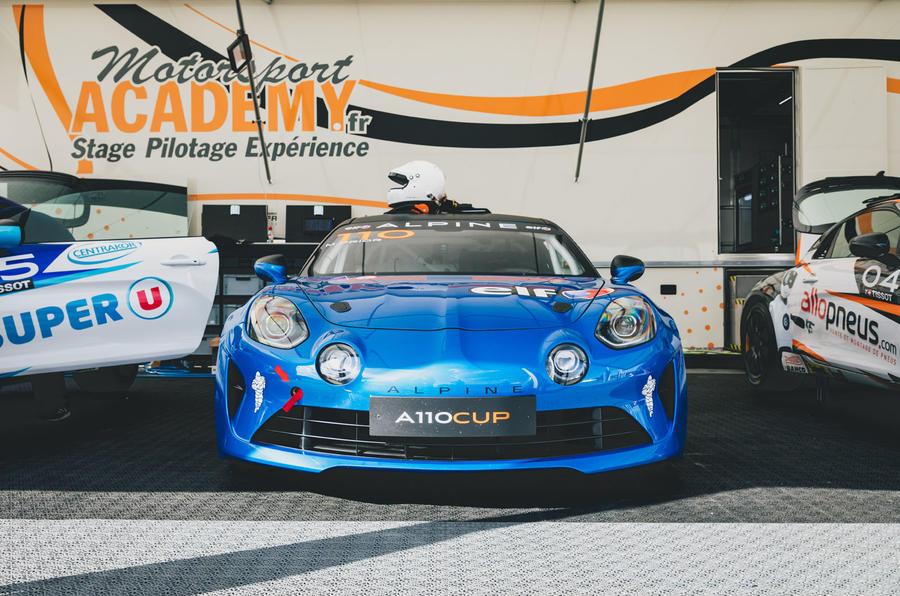 Blue alpine parked