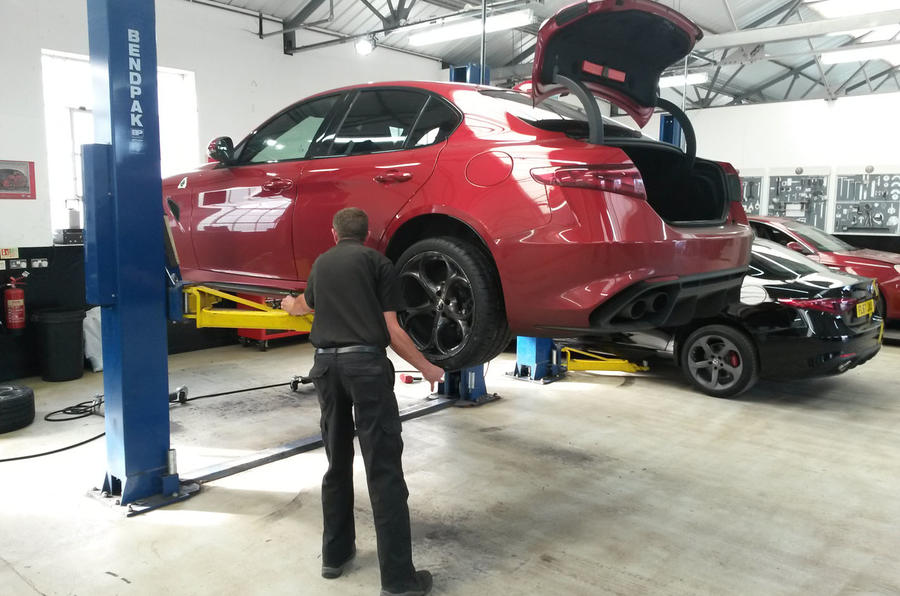 Alfa Romeo Giulia Quadrifoglio new tyres being fitted