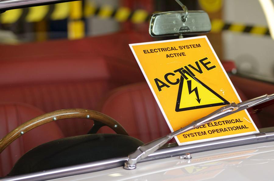 Aston Martin Works electric DB6 Volante - warning sticker
