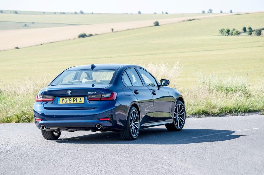 BMW 318d rear three quarters on the road