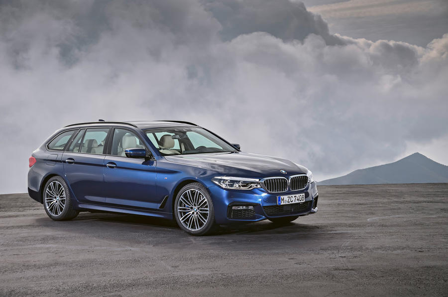 2017 BMW 5 Series Touring in front of mountains